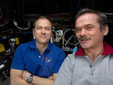 Commander Chris Hadfield (right) and<br /> Flight Engineer Tom Marshburn are<br /> pictured in the cupola on the International<br /> Space Station during the operations<br /> that ultimately led to the release of the<br /> SpaceX Dragon-2 spacecraft for its return<br /> to Earth.<br /> Credit: NASA<br /> <a href='http://www.nasa.gov/mission_pages/station/expeditions/expedition35/dragon_return.html' class='bbc_url' title='External link' rel='nofollow external'>� Learn more</a>